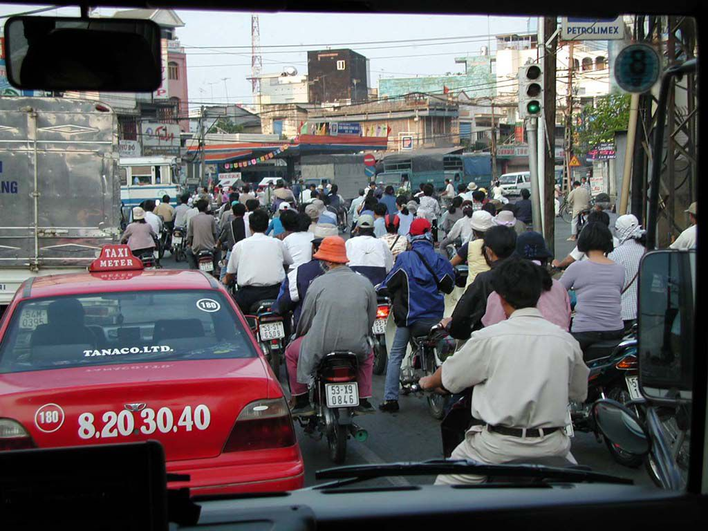 Typische Verkehrsszene in Saigon / Sai Gon / HCMC